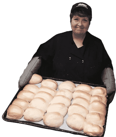 Woman holding tray of rolls